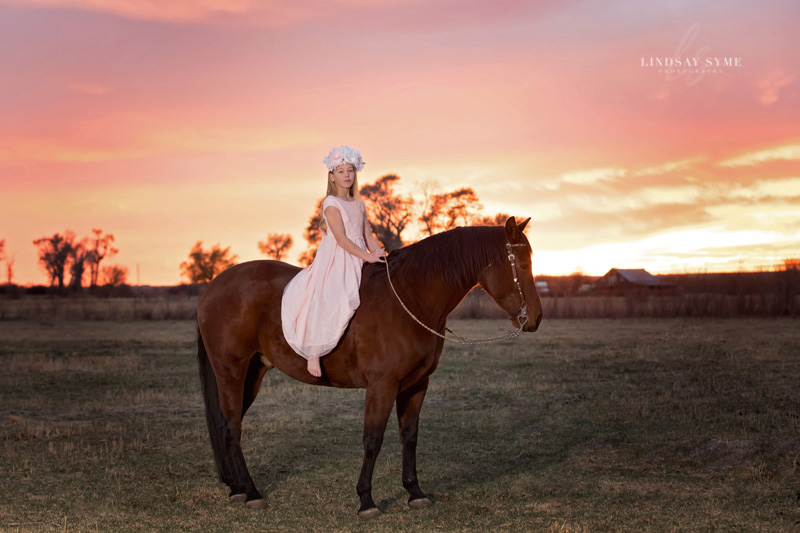 Just a Girl and Her Horse at sunset in Lamoille, Nevada